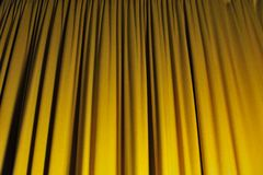 Yellow orange curtain. In a theatre Royalty Free Stock Photography