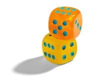 Yellow and orange dice Stock Photos