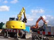 Yellow and orange diggers Royalty Free Stock Photography