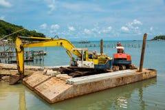 Yellow and orange excavator machine Stock Image