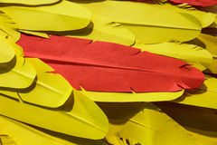 Yellow and orange feather Paper Stock Photos