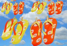 Yellow and Orange Flip Flops on Lines Stock Photos