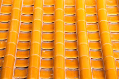 Yellow orange glazed terracotta  roof tiles of a Chinese temple Stock Photo