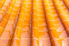 Yellow orange glazed terracotta roof tiles of a Chinese temple stock images