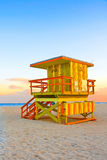 Yellow Orange and Green Lifeguard Tower Stock Images