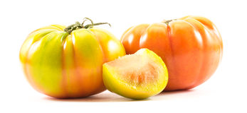 Yellow and orange lycopersicum tomatoes Stock Images