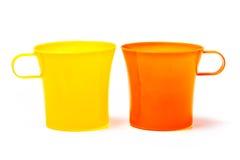 Yellow and orange mug isolated on white background Stock Images