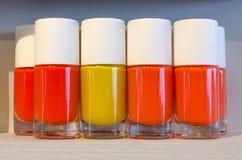 Yellow and orange nail polish bottles Royalty Free Stock Photography
