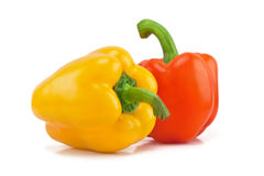 Yellow and orange peppers. Isolated on white background Royalty Free Stock Images