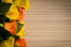 Yellow and orange roses background Stock Photo