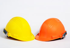 Yellow and orange safety helmet Royalty Free Stock Photography