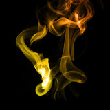 Yellow orange smoke Stock Images
