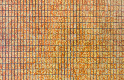 Yellow and orange stone ceramic tiles wall Royalty Free Stock Photography