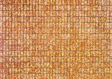 Yellow and orange stone ceramic tiles wall Stock Photo