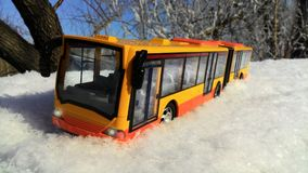 Toy bus in the snow Stock Images
