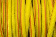 Yellow and orange water hose Royalty Free Stock Image