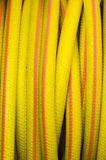 Yellow and orange water hose Stock Images