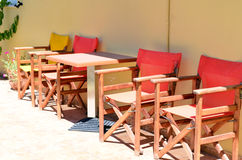 Yellow  and orange wooden armchairs outdoor Stock Photography