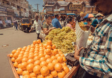 Yellow oranges on marketplace for sell and some customers of busy asian street market Stock Photo