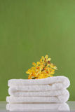 Yellow orchid on towel Royalty Free Stock Image