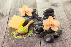 Yellow orchids, bath salt and soaps close-up Royalty Free Stock Photo