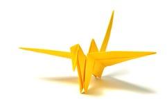 Yellow origami crane. Over white royalty free stock photo