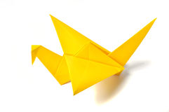Yellow origami crane. Over white stock image
