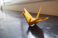 Yellow origami crane Stock Photos