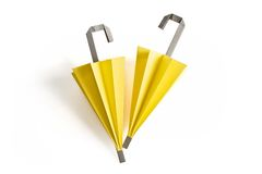 Yellow origami umbrellas. Two paper umbrella in yellow Stock Image
