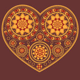 Yellow ornamental heart Stock Images