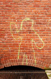 Yellow Outline Person and Brick Royalty Free Stock Photography