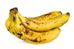 Yellow over ripe bananas. Isolated yellow over ripe bananas on white background Royalty Free Stock Photo