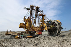 Yellow overburden excavator in brown coal mine Royalty Free Stock Photo
