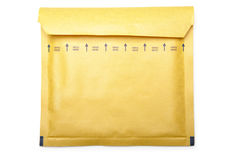 Yellow packaging envelope on white background Stock Images
