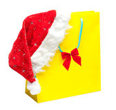 Yellow packet with santa hat Royalty Free Stock Images