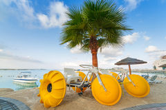 Yellow paddle boats on the coast of Persian Gulf Royalty Free Stock Photography