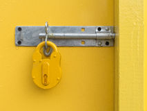 Yellow Padlock on Yellow Door Royalty Free Stock Photography