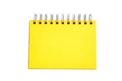 Yellow page of notebook. Blank Yellow page of notebook isolated on white background Royalty Free Stock Photo