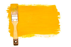 Yellow paint and brush Royalty Free Stock Images