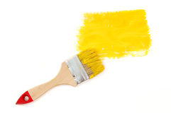 Yellow paint with brush Stock Photography