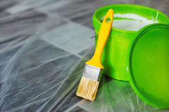 Yellow paint brush and green bucket Stock Photography