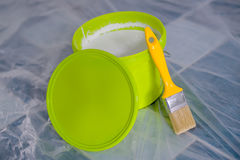 Yellow paint brush and green bucket Royalty Free Stock Photos