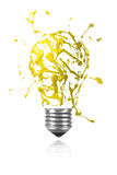 Yellow paint burst made light bulb Stock Photography