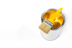 Yellow paint can. With brush isolated on a white background - with clipping path stock photos