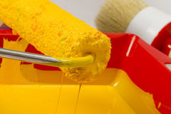 Yellow paint can and roller Royalty Free Stock Photos