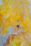 Yellow paint and crack on old concrete wall Stock Images