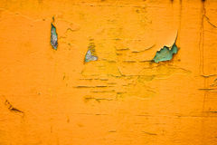 Yellow paint crack on wood Stock Images