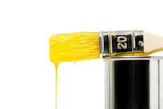 Yellow paint dripping from paintbrush Royalty Free Stock Image