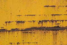 Yellow paint mottled tin Royalty Free Stock Image