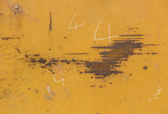 Yellow paint mottled tin. Yellow color paint mottled weathering of rust Stock Photo